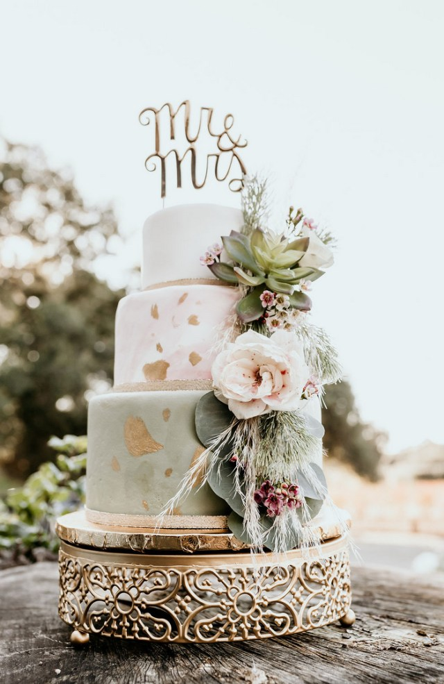 The wedding cake was done in white, marble pink and green plus metallic foil and lush blooms