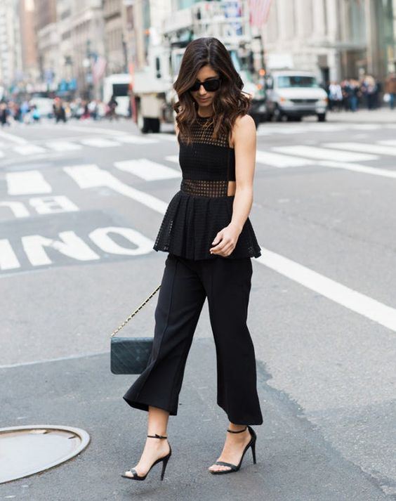 black culottes, black heels, a black bandeau top, a black peplum see-through top amd a grey bag