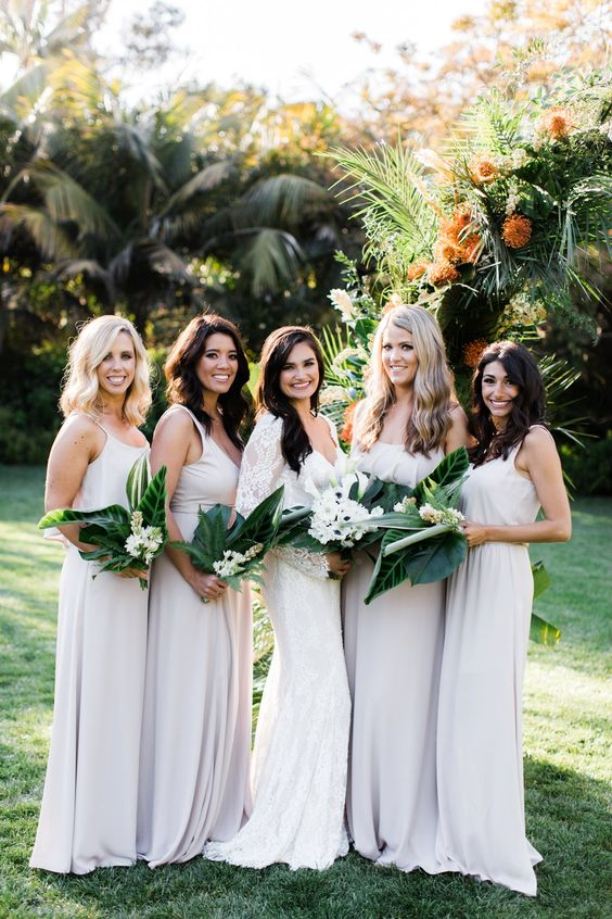 off-white spaghetti strap maxi bridesmaid dresses are a great idea as whites reflect sunlight