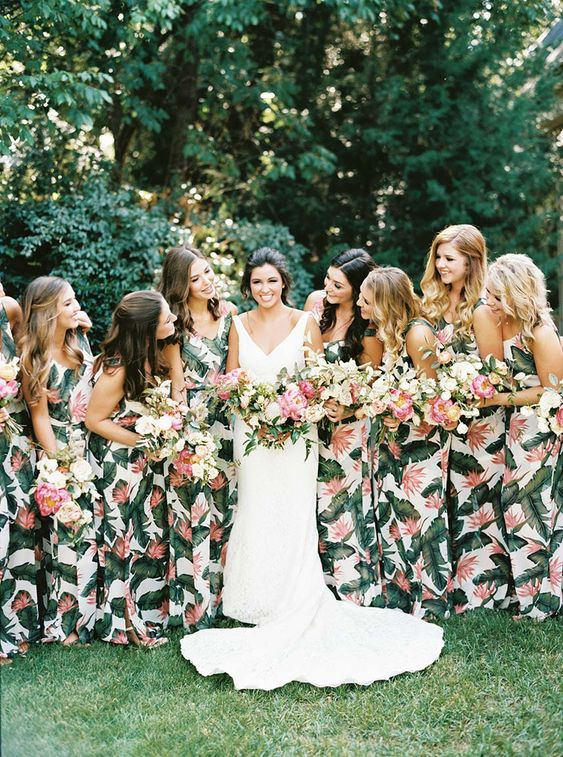 matching thick strap maxi bridesmaid dresses with tropical leaf prints are a timeless idea for a tropical wedding