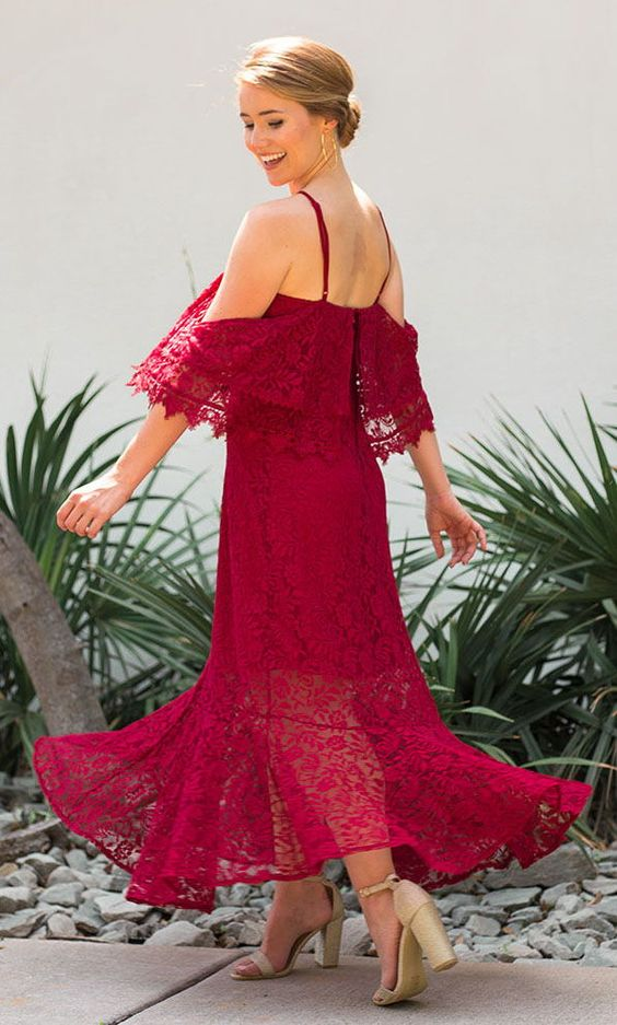 a spaghetti strap fuchsia lace maxi dress wth nude shoes for a bright summer wedding