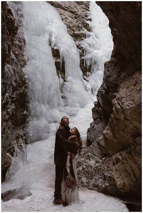 a frozen waterfall is a fantastic place to tie the knot, it looks like an ice fairytale