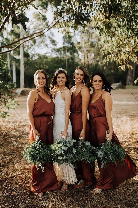 burgundy slip maxi bridesmaid dresses with deep necklines are a bold idea for a fall wedding
