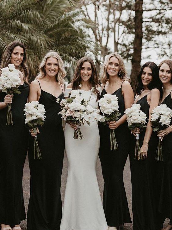 black slip maxi bridesmaid dresses with V-necklines and slight mermaid silhouettes