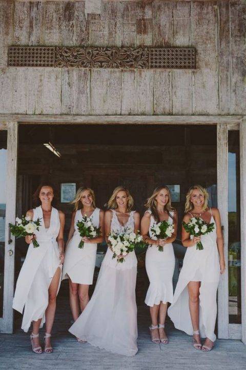 gorgeous mismatching modern white bridesmaid dresses and blush strappy shoes