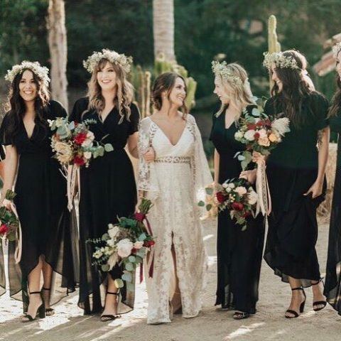 black midi dresses with high low skirts and floral crowns look gorgeous for a boho wedding