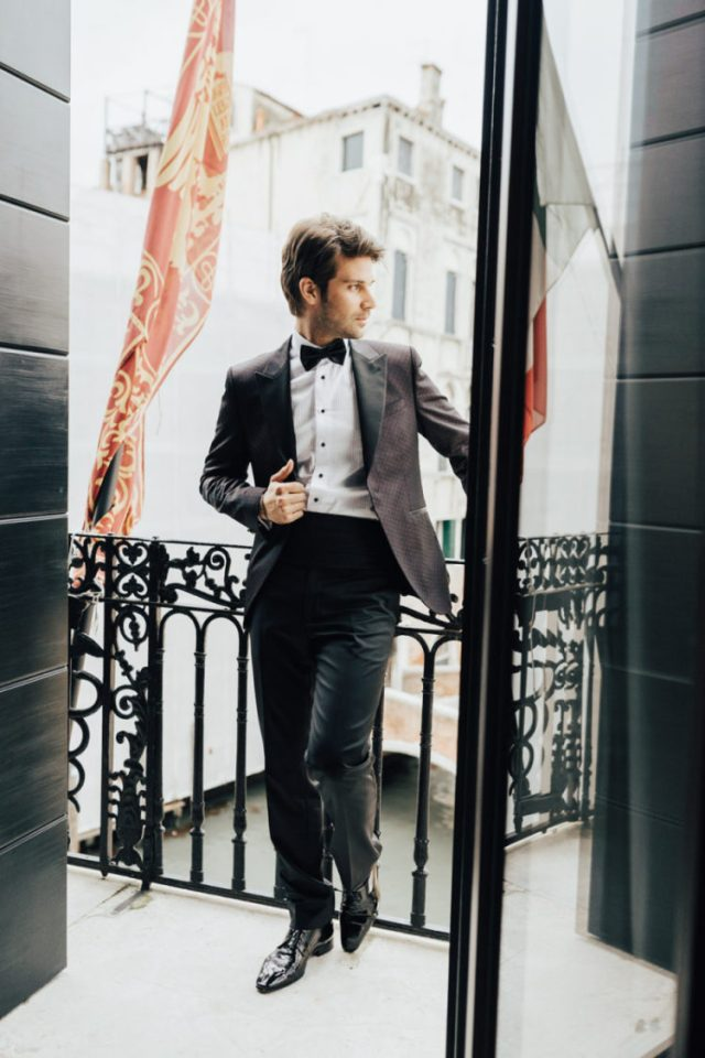 A classic tux but with a printed blazer is a chic and refined idea for a groom
