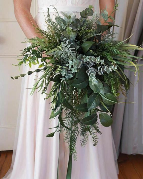 a greenery wedding bouquet with plenty of texture is a creative idea to get a stunning bouquet and not to waste money