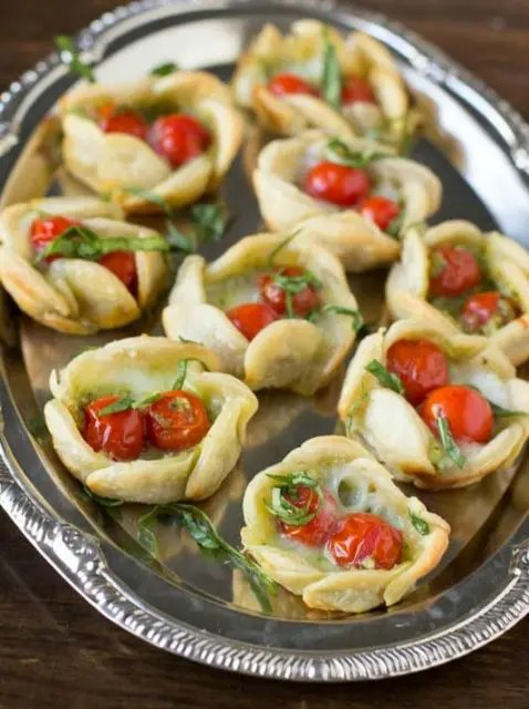 pastry cups with sundried tomatoes and fresh herbs are tasty snacks suitable for vegan weddings