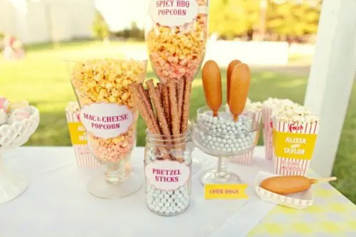 popcorn, pretzel sticks, corn dogs will please the crowd as these are popular snacks
