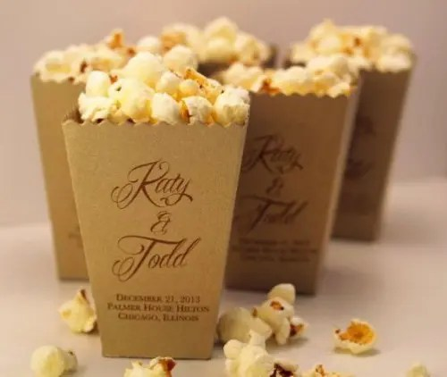 boxes with fresh popcorn - salted or sweet - can be a nice snack idea for a wedding