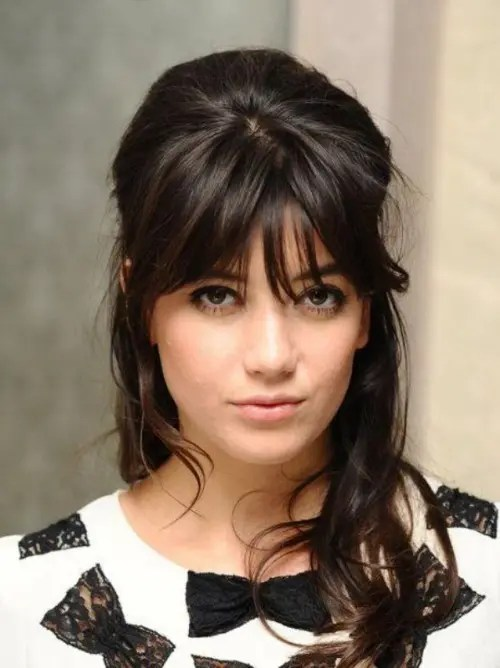 a long and wavy half updo with bangs ad a bump is a chic idea for long or medium length hair