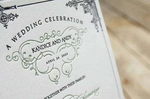 a wedding invite decorated with emerald patterns and calligraphy