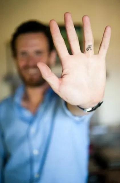 A secret monogram tattoo idea for men - tattoo the monogram of your partner