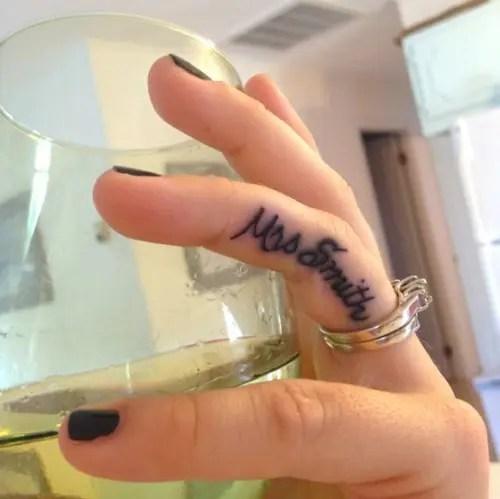 A creative cursive wedding tattoo showing off your new marital status