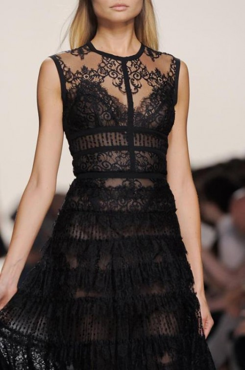 a semi sheer fitting black lace wedding dress with an illusion neckline, no sleeves