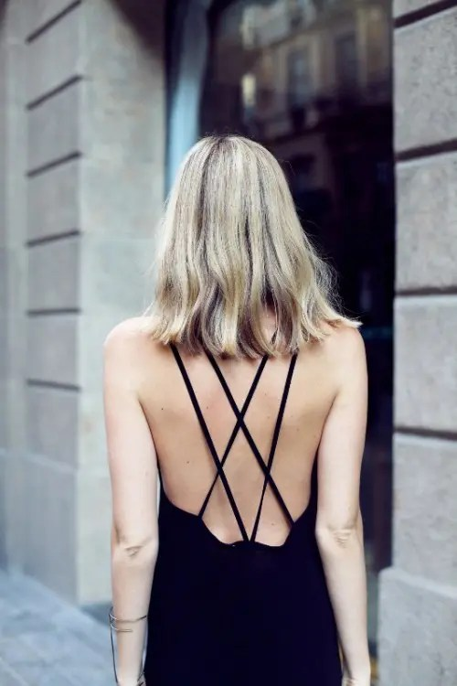 a modern black wedding dress with a criss cross back for a soft gothic bride