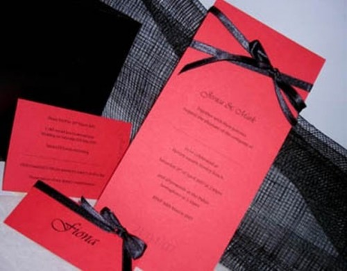 red wedding stationary with black bows is a timeless combo with an elegant feel