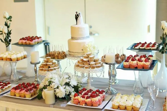 Gorgeous Wedding Dessert Table Decor With Pink Chocolate Sticks And Colorful Cans