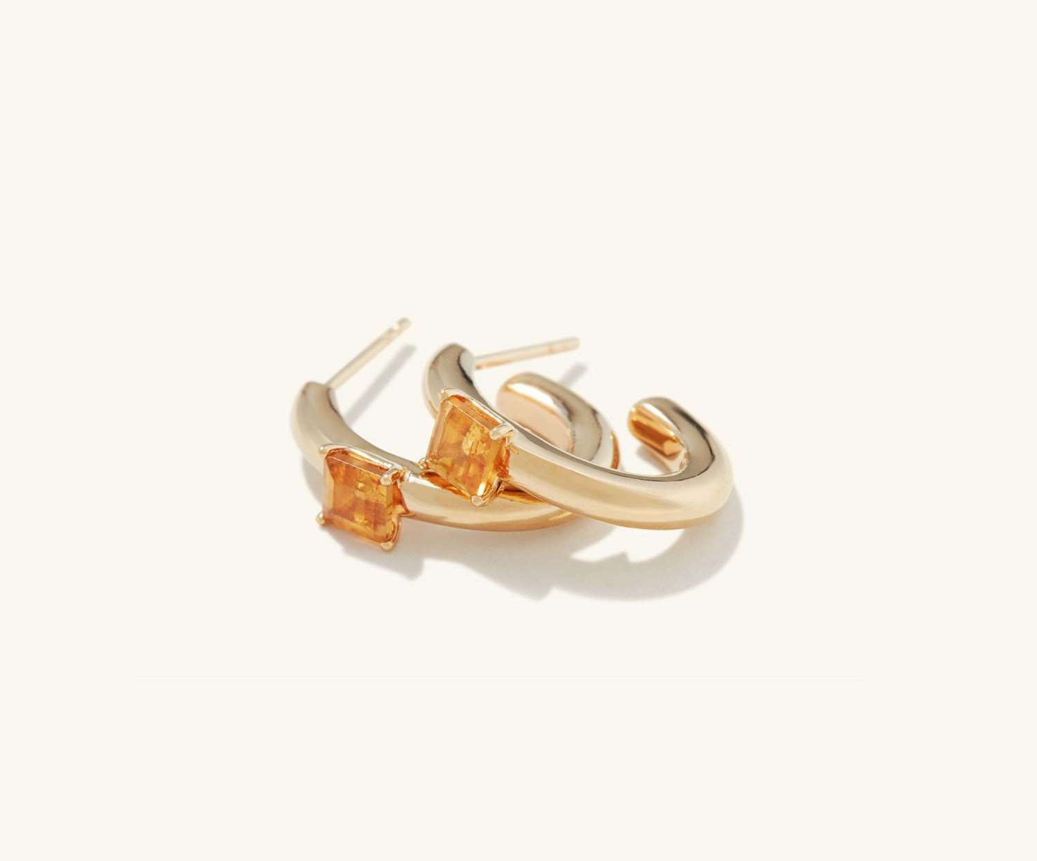 Hoop-shaped gold wedding earrings with a citrine stone accent