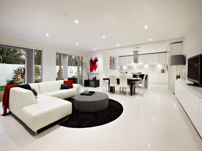 Open plan living room using black colours with tiles  french doors  Living Area photo 491980