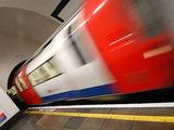Tube train leaving a station