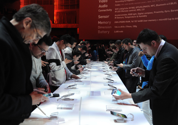 People eagerly check out the Galaxy S4 after its launch at Radio City Music Hall