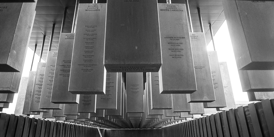 Image credit: Memorial Corridor at the National Memorial for Peace and Justice (detail), Montgomery, Alabama (800 six-feet-tall hanging steel monuments, one for each county where a lynching took place, with the names of the victims engraved on them).