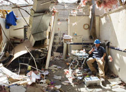 VILONIA, ARKANSAS - APRIL 28: Victor Umbright of Vilonia Direct TV, sits in what is left of his office after a tornado yesterday tore through the area for the second time in three years, on April 28, 2014 in Vilonia, Arkansas. (Photo by Wesley Hitt/Getty Images)