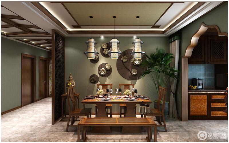 kitchen lanterns apron sink 餐厅与厨房通过木质花型结构区分 暗绿色的墙面悬挂着青铜装饰品 与实木 暗绿色的墙面悬挂