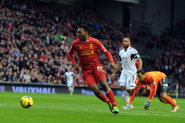 Daniel Sturridge rounds Michel Vorm