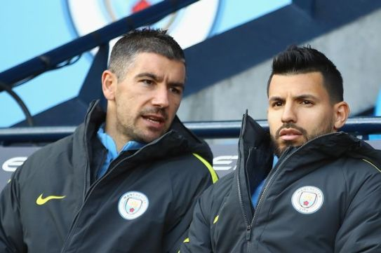 Sergio Aguero looks on from the bench.