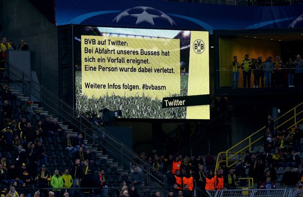The video board reports about a bomb attack to the bus of Dortmund