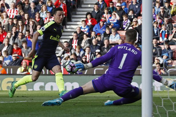 Mesut Ozil scores their second goal