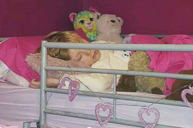 Tegan, who was born in May 2009, is pictured sleeping in her pink bed