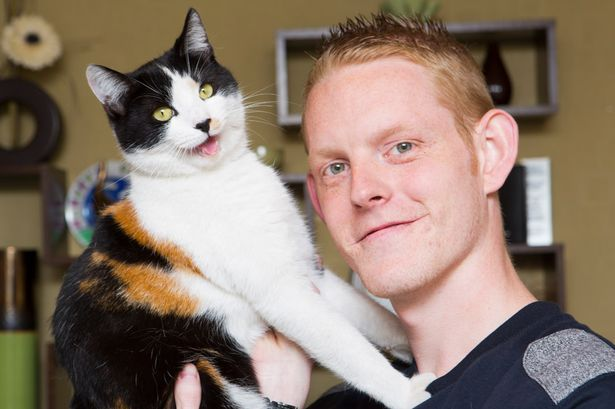 Richard Smith with Jake the cat thought to be the rarest domestic cat in the country