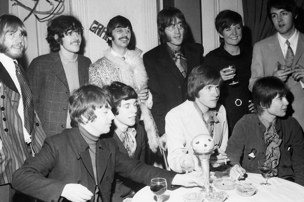 John Lennon and Ringo Starr of The Beatles (back row centre) stand with Rolling Stone Brian Jones (far left), folk singer Donovan (second left), Cilla Black (second right) and Paul McCartney (right) as they pose with the Apple managed band Grapefruit at a launch party to celebrate their debut, 'Dear Delilah' on RCA. 19 January 1968