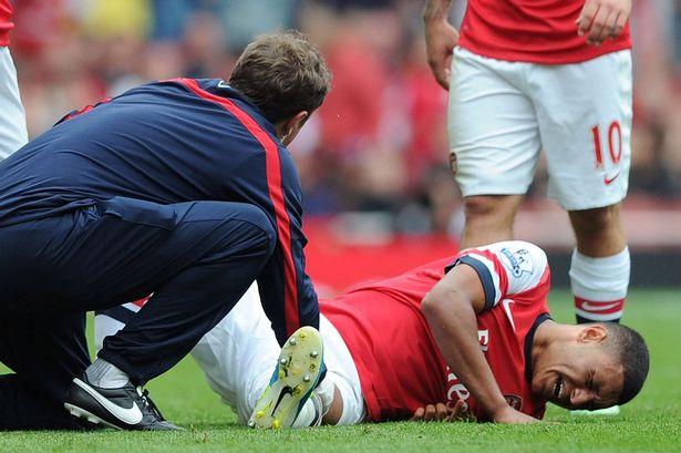 Oxlade-low: Arsenal's physio checks the injured star