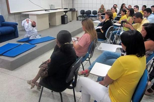 Claudio Vieira de Oliveira, 37, giving a talk to students at a university in Feira de Santana