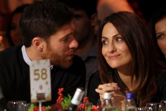 Xabi Alonso and his wife Nagore Aramburu attend the FC Bayern Muenchen christmas party at Schuhbeck's Teatro restaurant on December 7, 2014 in Munich, Germany.