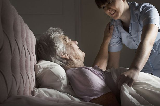 Carer looking after senior woman