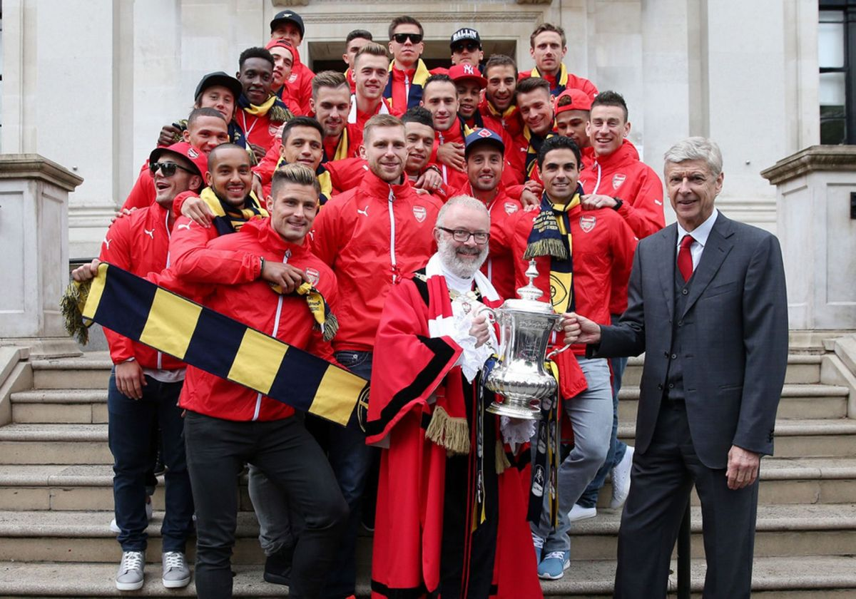 The Arsenal team celebrate winning the FA Cup at Islington Town Hall