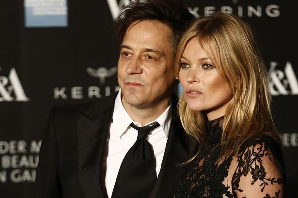 British model Kate Moss (R) and her husband Jamie Hince