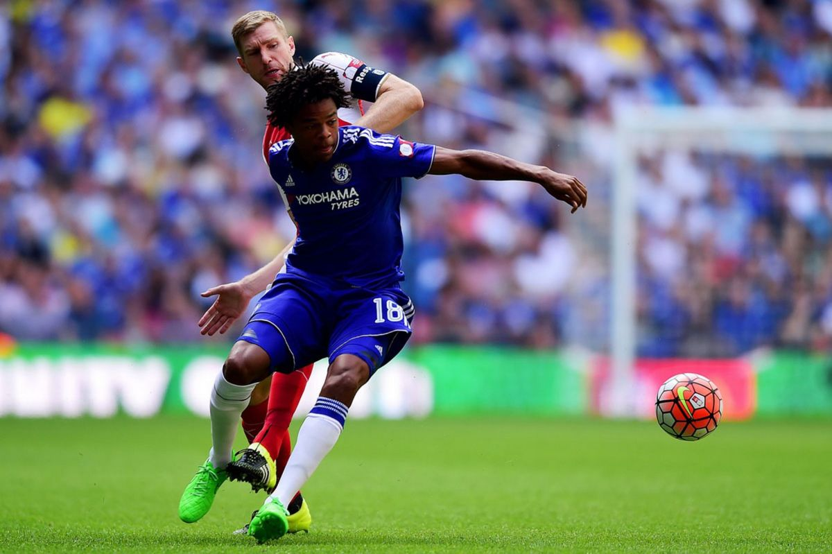 Loic Remy and Per Mertesacker compete for the ball