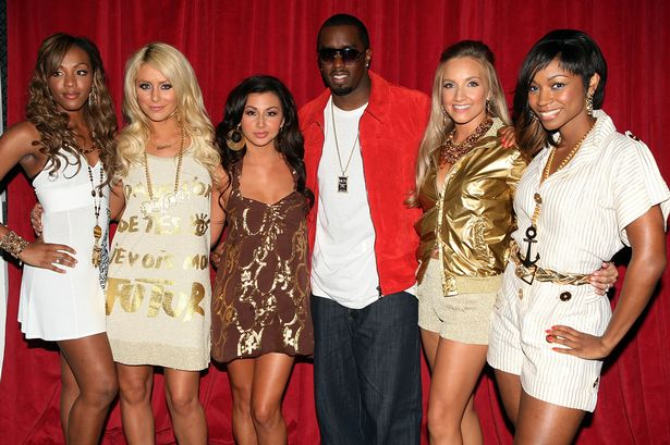 """Sean """"P. Diddy"""" Combs poses with Danity Kane"""