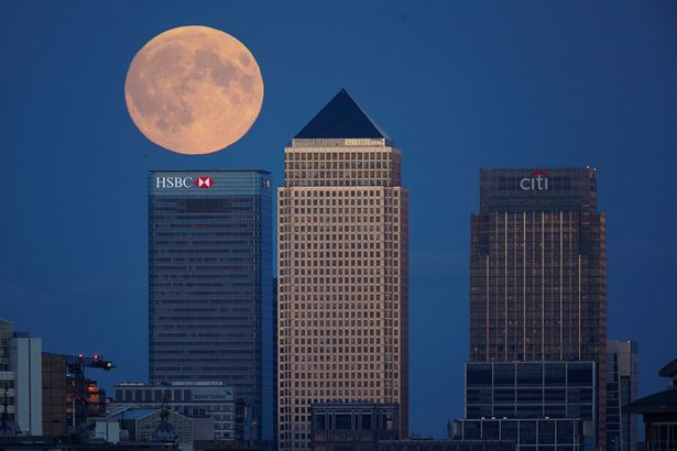 The moon rises over Canary wharf at it's closest point to the earth during a Supermoon phase on September 27, 2015