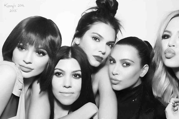 The Kardashian-Jenner sisters cuddle up for group snap at Kendall's birthday