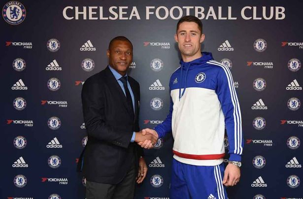 Gary Cahill with Michael Emenalo, after the announcement of Cahill's new contract at the Cobham Training Ground