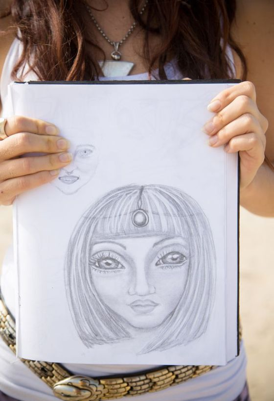 A group of women called the Hybrid Baby Community are claiming they have children which were fathered by aliens who live with their dads on giant spaceships and have sketched how the aliens look. Pictured - One of the sketches by Aluna Verse