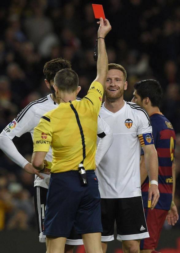 The referee shows a red card to Valencia's German defender Shkodran Mustafi